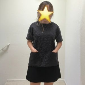Speckled top with sequin front pockets